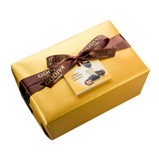 The classic and elegant Belgian ballotin wrapped in luxurious gold paper with a hand-tied ribbon contains a rich assortment of Godiva premium chocolates.