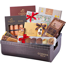 Celebrate Christmas 2016 and New Year's with this ultra-indulgent collection of Godiva truffles, bars, coffee, bonbons and Belgian chocolate pralines. In a lovely, rich chocolate brown basket, a true chocolate connoisseur's feast awaits!