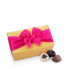 Celebrate spring with Godiva's elegant Belgian chocolate ballotin dressed up in seasonal wrapping, a timeless indulgence