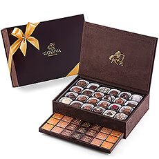 To give a truly wonderful chocolate gift, Godiva offers its beautiful keepsake gift box. Godiva`s Royal Boxes are brimming with Godiva`s amazing array of delicious chocolates and tantalizing carrés. Each box makes a wonderful gift for a friend, colleague or to bring to the family get-togethers.