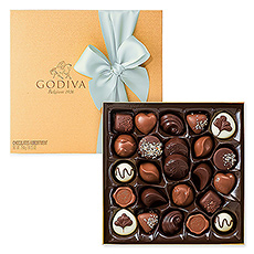 Godiva's signature chocolate ganaches, pralines, and caramels offered in a classic gold box with a festive spring wrapping