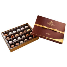 This large, elegant box of finest handcrafted truffles is a dream to receive, share or savour to yourself.