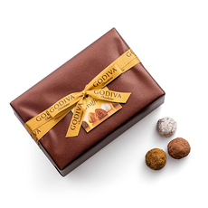Dive into the pleasures of the classic Godiva Truffle Ballotin. Inside the luxuriously packaged gift box, discover layer upon layer of Godiva's finest chocolate truffles.