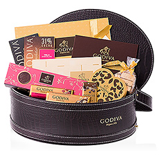 The ultimate gift for true connoisseurs of Godiva chocolate. A luxurious, leather gift basket is filled with a rich assortment of the finest Belgian chocolate that every Godiva fan dreams of: pralines, truffles, biscuits, chocolate bars and tablets, and so much more.