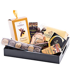 This stylish Godiva gift set is the ideal way to spoil that special someone with sophisticated taste. A luscious collection of Godiva milk and dark chocolates, truffles, Pearls, and more is elegantly presented in a sleek black serving tray.