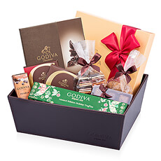 An abundance of Godiva Christmas chocolates, pralines, truffles, Carrés, and other chocolicious treats fill a signature Godiva leather style gift hamper. Let the festivities begin!