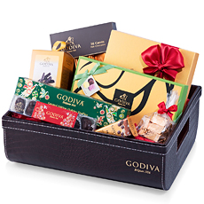 Make the holidays extra special with this impressive Godiva Christmas gift basket. An abundance of Godiva chocolates and truffles are impressively displayed in the luxurious croco leather style signature Godiva hamper.