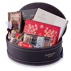 Treat your friends and family to this spectacular Godiva chocolate gift hamper overflowing with holiday cheer!