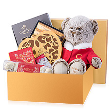 Send warm Christmas wishes with this fabulous Godiva gift featuring the limited-edition Christmas 2017 Godiva plush bear and a generous collection of Godiva milk, dark, and white chocolates.