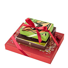 A trio of luxury Godiva chocolate gift boxes are stacked high in this elegant Christmas gift tower. Each box features a different unique Godiva specialty for a delicious variety of flavors.