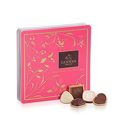 Indulge in this heavenly collection of your favorite Godiva biscuits nestled together in a handsome tin box.