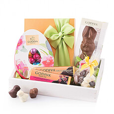 This spring, treat your loved ones to the best Godiva Easter chocolate presented in a stylish white wooden gift tray.