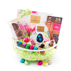 Welcome springtime with this charming basket full of Godiva Easter chocolate treats.