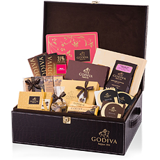 This gift hamper offers a spectacular array of Godiva pralines, chocolate truffles, tablets, bars, biscuits and coffee.
