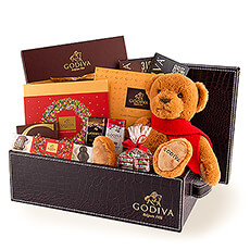 Christmas will be unforgettable when you send this luxurious croco leather hamper with the limited edition Godiva 2018 Christmas teddy bear and a broad selection of Christmas and classic chocolates. There is a treasure trove of Godiva Belgian chocolates in this luxury gift - enough for the whole family to share!