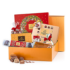For Christmas 2018, Godiva reveal a beautiful golden gift box full of delicious chocolates and truffles.