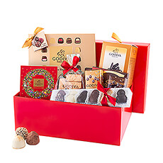 Discover this luxurious red gift box filled to the brim with the most delicious Godiva holiday chocolates. This decadent Christmas gift includes a wealth of Godiva truffles, chocolates, Orangettes, tablets, and more.