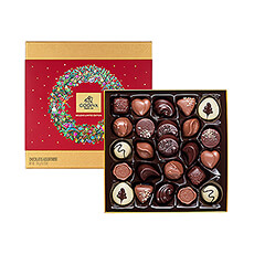 For the holidays, Godiva has decorated the classic gold rigid box with a festive red bow and decorative Christmas sleeve with a whimsical Holiday Wreath.