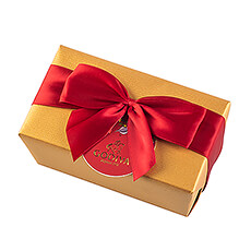 The timeless Godiva Gold Ballotin is all dressed up for the holidays with a satin ribbon and a tag shaped like an ornament.