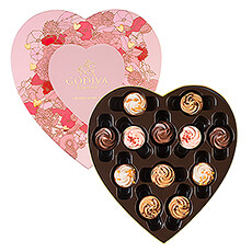 The pink heart box, decorated with stylish floral motif, offers a delicious selection of limited-edition cupcake chocolates.