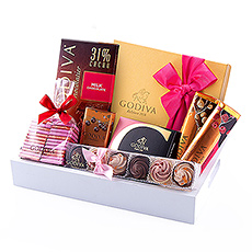 The Godiva 2019 Valentine Gift Tray offers a delicious selection of loving chocolates to win his or her heart.