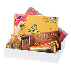 Shake up your senses with the limited-edition Godiva Chocolate Carnival Gold gift tray.