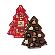 Discover 11 of the best chocolates with refined toppings and tasty fillings, in white, dark and milk chocolate, packed in a cute box in the shape of a Christmas tree