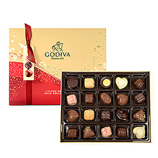New for Christmas 2020! Unwrap Godivas limited-edition Christmas Sparkle Chocolate Collection in a variety of wonderful flavours. An elegant red and gold gift box with a sparkle design contains a very special suprise: five brand new Godiva chocolate creations that are delicious on the inside and sparkling on the outside. Each of the milk, dark, and white chocolates is dusted with sparkling edible glitter for an unforgettable chocolate experience. The gift box contains 20 pieces.