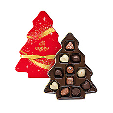 What better gift to give this Christmas than a festive Christmas tree gift box filled with delicious Godiva chocolates? Discover 11 of our most iconic milk, dark, and white chocolates with refined toppings and scrumptious fillings such as praliné, ganache, and caramel. This gift is sure to bring a smile to every chocolate lovers face.
