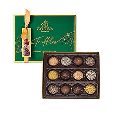 Indulge in the delicious world of Godiva truffles. This rich green Christmas gift box offers 12 handmade truffles in a limited-edition collection of white, dark and milk chocolate. Each truffle has an exquisite topping on the outside and a surprising flavour on the inside, including mousse, caramel, and more. Discover them all this Christmas.