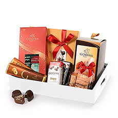 Treat your favorite chocolate lover to this stylish Christmas gift featuring their favorite Godiva classics. From Christmas Carrés to heavenly traditional truffles to the signature gold rigid gift box with Godiva's most iconic filled milk, dark, and white chocolates, this holiday gift set truly has it all! Milk and dark chocolate Pearls, hazelnut Lingot Noisettines, and two scrumptious chocolate bars complete this fabulous chocolate gift for Christmas 2020.