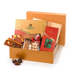 The holidays will sparkle and shine with this rich Godiva golden gift box full of the best Christmas chocolate, including the new limited-edition Sparkles Christmas Collection. Delicious Carrés, chocolate bars, Pearls, and Lingot Noisettes ensure that your loved ones will have plenty of Godiva chocolate to enjoy throughout the festive season.