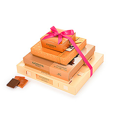This beautiful Godiva chocolate gift tower is pure elegance and style. Four golden gift boxes are stacked high and tied with a pretty pink ribbon for the perfect gift for Mother's Day and other occasions. Each gift box reveals an exquisite Godiva chocolate treasure, with over 90 pieces total.